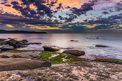 Gentle Seas and Pretty Clouds Sunrise Seascape (Merrillie) Tags: daybreak sunrise cumulus nature dawn coast water morning sea newsouthwales rocks pearlbeach nsw rocky waterscape ocean earlymorning landscape waves coastal clouds outdoors seascape australia centralcoast sky seaside