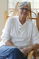 Martha Coleman sits in a rocking chair in her sun room.