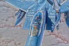 F-15E Over Iraq, variant (sjrankin) Tags: kc135 aerialrefueling afcent stratotanker iraq aludeidairbase qatar qa 181025fev3100130 unitedstatesairforce f15e refueling clouds