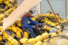 In the Nets (Beegee49) Tags: fisherman mending nets repairing fishing sewing sea boat panasonic fz1000 happyplanet cadiz city negros occidental philippines asia port