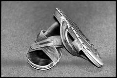 event horizon (Aspenlaub (blattboldt)) Tags: sandals shoe monochrome stilllife zeiss sony carlzeiss ilce7rm3 alpha7riii manualfocus manualiris manualexposure specialthankstochristophecasenaveandhisteamfromzeissfortheirpersonalinvolvementinthedevelopmentoftheloxialensline ⚶ emount manualwhitebalance nārrātō laudātū wabisabi 侘寂 無常 mujō loxia2485 loxia2485sonnar 85mm 51695547 sonnar physiognomic choreographic shallowdepthoffield dof rhapsodic episodic grey silver handheld europe germany