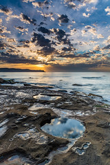 Sunrise Seascape with Clouds (Merrillie) Tags: daybreak sunrise cumulus rockpools nature dawn reflections coast water morning sea newsouthwales rocks pearlbeach nsw rocky waterscape ocean earlymorning landscape waves coastal clouds outdoors seascape australia centralcoast sky seaside