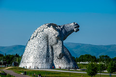 Gateway (Tony Shertila) Tags: scotland andyscott britain canal europe falkirk horse kelpies monument ourdoor sky statue structure thehelix water grangemouth unitedkingdom 20180528172500scotlandfalkirkkelpieslr ststue horses tree mountain