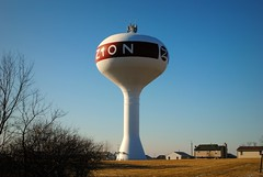 Zion, Illinois (Cragin Spring) Tags: watertower house sky blue illinois il lakecountyil unitedstates usa unitedstatesofamerica zion zionil zionillinois
