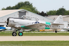 N7090C - 1957 build North American SNJ-4 Texan, departing from Runway 27 at Oshkosh during Airventure 2018 (egcc) Tags: 370 27754 8813370 airventure airventure2018 bormes eaa harvard kosh lightroom n7090c northamerican osh oshkosh snj4 texan usnavy warbird
