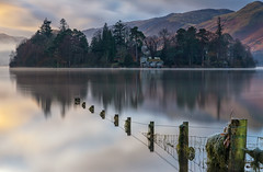 Derwent Water (gmorriswk) Tags: keswick derwent water derwentwater long exposure reflection reflections waterscape sunrise tree mountain fence mist fog mountains hill hills lake district firecrest hitech formatt