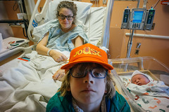 (patrickjoust) Tags: sony a7 digital adapter manual focus lens patrick joust patrickjoust child baltimore maryland md usa us united states north america estados unidos voigtlander colorskopar 21mm f4 wide angle llewelyn kid boy orange video game hat baby geneva amy mother smile hospital bed