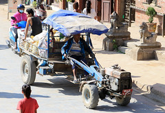 A Nepalese delivery vehicle in Patan (Dave Russell (1.3 million views thanks)) Tags: vehicle transport local locals peasant peasants people machine machinery man men tractor delivery street road nepal patan travel tourism car van lorry engine color colour canon eos eos7d 7d latipur kathmandu
