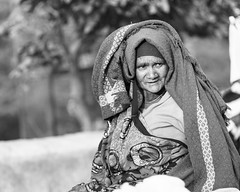 Woman with blanket (thomas.pirolt) Tags: india goverdhan radhakund streetphotography street streetlife sony a7 a7ii people portrait candid moment theindiatree takumar smc 85mm 18 old blackandwhite bw