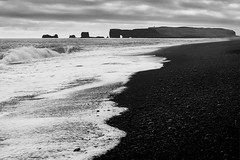 Black Sand Beach (azhukau) Tags: reynisfjara iceland shore shoreline sand black waves sea ocean oceanside seascape outdoors travel famousplace tourism monochrome blackandwhite scenics nopeople beach blacksandbeach landscape beautyinnature sunset cloud mcrokkorpg58mmf12 minolta vintagelens