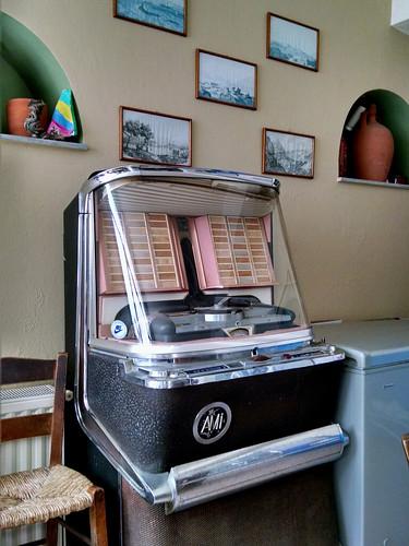 Vintage AMI jukebox in Kafeneion/Mini-Market, downtown Falatados, Tinos