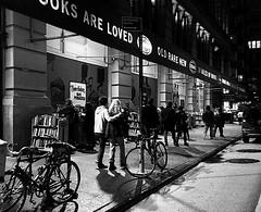 Books Are Loved (Demmer S) Tags: nighttime night dark evening nightshot nightimages nightout nightlife nightphotography atnight cityatnight citylights bookstore books bookstacks bookshelves book shelves bookseller bookshelf bookstores strandbookstore independentbookstore eastvillage publishing print printing pages authors writers retail business store merchandise textbooks literary reading writing printed textbook browsing display ny newyork nyc newyorkcity manhattan eastcoast bw monochrome blackwhite blackandwhite blackwhitephotos blackwhitephoto signage signs words typography logo streetsign text sign type word advertising visual streetsigns street streetphotography people bikes bicycles streetshots documentary citylife