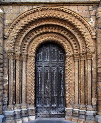 Norman/Romanesque portal - west front, Lincoln Cathedral, Lincolnshire, England. (edk7) Tags: olympuspenliteepl5 edk7 2016 uk england lincolnshire lincoln lincolncathedral cathedralchurchoftheblessedvirginmaryoflincoln stmaryscathedral englishdecoratedgothic cathedral church norman romanesque door portal sculpture stonecarving architecture building oldstructure gradeilisted art atrwork medieval artwork