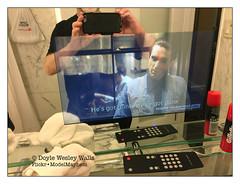 "Watching ""The Godfather: Part II"" on My Bathroom Mirror in My Park Avenue Hotel Room (Doyle Wesley Walls) Tags: lagniappe 7681 thegodfatherpartii robertdeniro guns text words dialogue subtitles bathroom tv television mirror iphonephoto hotel film movie remote shavingcream towel doylewesleywalls classic"