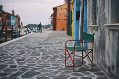 Absence (Marta Marcato) Tags: chair empty void absence venice venezia burano italy italia colors color man working street outdoor clouds water island nikond7200