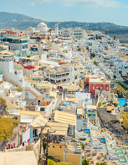 The traditional blue and white village of Fira in Santorini, Greece (T is for traveler) Tags: fira santorini greece travel tourism mediterranean thira greek city town view architecture village panorama house landscape urban cityscape houses blue sea building europe buildings sky old hill ocean tradition destination day panoramic island white freedom nopeople traditional restaurant cliff areal skyline canon 5d markii yongnuo 50mm
