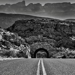 A Graveled Road Leading off to Peaks of the Sierra del Carmen (Black & White, Big Bend National Park) thumbnail
