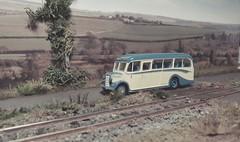 London Bound. (ManOfYorkshire) Tags: tmf700 lodges coach bus beford ob duple vista efe diecast scale model oogauge 176 diorama london bound railway train track