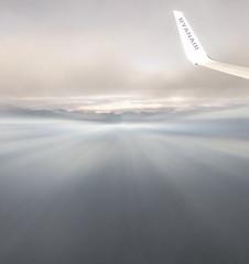 In the clouds (Jean-Luc Peluchon) Tags: cloud nuage ciel sky sunset sun avion plane airplane aircraft hublot window altitude brouillard mist haze fog ray light spotlight rayon flight