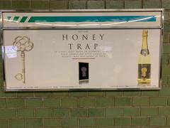 HONEY TRAP (Hideki-I) Tags: subway ad word bottle poster iphone osaka japan
