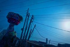 Wires in the blue sky (fredo f) Tags: nigeria afrique africa lagos street rue wire fil bleu heurebleue bluehour blue boisson drinks beverage sky ciel