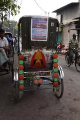 Decorated rickshaw on the streets of Kolkata / Calcutta (sensaos) Tags: asia india calcutta kolkata travel sensaos 2013 city urban rickshaw street publictransport market district people