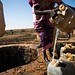 Fetching water at a well, Darfur