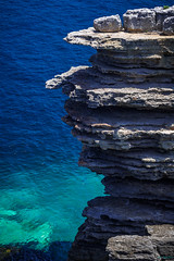 Cliff Face of Outer Tubes (ian_underthesea) Tags: cliff jervisbay nsw coast seascape telephoto rocks ocean blue aqua outertubes