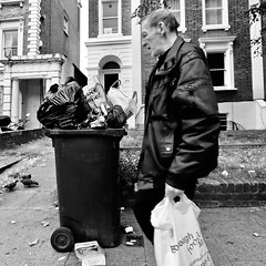 IMG_8150s (JetBlakInk) Tags: brixton men mono subject2ground streetphotography rubbish dustbin