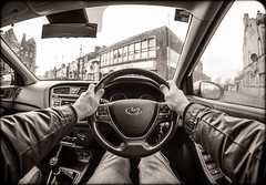 Drive. (CWhatPhotos) Tags: cwhatphotos olympus penf m zuiko 8mm prime lens f18 mzuiko four thirds wide angle fisheye fish eye view digital camera photographs photograph pics pictures pic picture image images foto fotos photography artistic that have which with contain artistc art light auto automobile car white hyundai i20 12se 12 se vehicle 2017 new brand inside cab dashboard controls man male driver driving interior goatee sepia tint hands steering wheel looking out