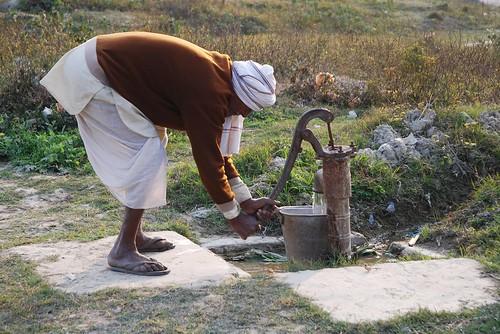 Farmer at water pump in Bihar, India