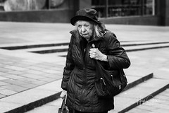Old Lady (HughGilliland) Tags: blackandwhite mono white black culture society humanity living naturallight bokeh female feeling eyes tones tone mood expression face streetstyle candid portrait streetphotography street city urban women oldlady lady