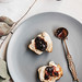 Top view of english brunch- homemade scones with jam on grey plate
