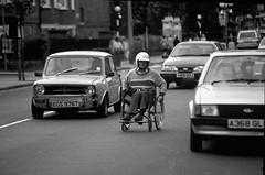 disabled man in traffic (hoffman) Tags: disability handicap horizontal traffic transport wheelchair british health infirmity uk unitedkingdom affliction disabled disablement disadvantage handicapped impairment impediment incapacitated incapacity davidhoffman wwwhoffmanphotoscom