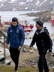 Greenland Teenager and Roger (oxfordblues84) Tags: oat overseasadventuretravel ammassalik ammassalikisland tasiilaqgreenland tasiilaq eastgreenland greenland roger teenager boy soccerplayer greenlanderteenager greenlanderboy water harbour harbor tasiilaqharbour boat boats ship red snow