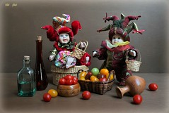 Harvest Folks (Esther Spektor - Thanks for 12+millions views..) Tags: stilllife naturemorte bodegon naturezamorta stilleben naturamorta composition creativephotography art harvest doll tabletop scene joker food tomato basket barrel bottle jag glass wooden wicker pattern costume ambientlight red yelllow green golden burgundy brown estherspektor canon