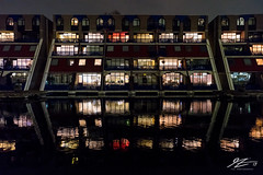 Agent Voyeur (TVZ Photography) Tags: netherlands holland night evening longexposure lowlight sonya7riii zeiss loxia 21mm flats apartments architecture building rotterdam city water reflection