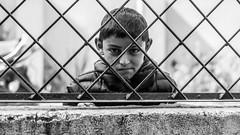 Looking In (#Weybridge Photographer) Tags: canon 5d mk ii eos slr dslr nepal asia kathmandu mkii boy child monochrome fence bars