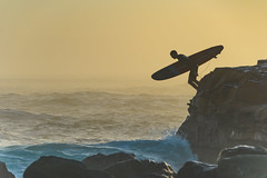 Surfer and the Rocky Headland (Merrillie) Tags: surfing sunrise people headland water centralcoast morning sea rocky coastal newsouthwales rocks earlymorning nsw sky jump ocean landscape waterscape coast surfer avocabeach outdoors seascape australia yellow nature waves