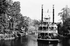 A Cruise Down The River (dualdflipflop) Tags: disneyland disney film 35mm riverboat f100 nikon nikonf100 filmphotography blackandwhite bw