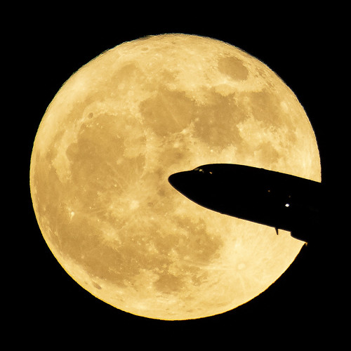 Aircraft taking off from Ronald Reagan National Airport is seen passing in front of the Moon as it rises in Washington, Sunday, Dec. 3rd, 2017. Original from NASA. Digitally enhanced by rawpixel.