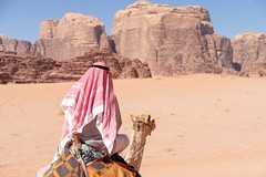 Riding with a Bedouin in Wadi Rum (George Pachantouris) Tags: jordan hasemite petra aqaba amman middle east travel tourism holiday warm arab arabic wadi rum desert bedouin camel sand heat