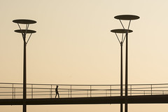 Four street lamps and a man (Jan van der Wolf) Tags: map186249v streetlamp streetlight straatlantaarn zoetermeer brug bridge fietsbrug silhouette people candid eveninglight avondlicht sunset