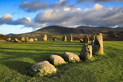 Ancient shadows (jeff.dugmore) Tags: england britain uk europe cumbria lakedistrict keswick castlerigg mountain mountainside castleriggstonecircle stonecircle mystical ancient neolithic history englishheritage nationaltrust rural landscape nature outside outdoors clouds light goldenhour tranquil serene grass green shadows cannon nisi hillside hillwalking sky blue stones scenic nationalpark lakedistrictnationalpark countryside