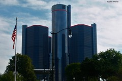 Blue Skies-a tribute to Michigan veterans and those around the world (SCOTTS WORLD) Tags: adventure america architecture armedforces sky shadow sunlight sign september 2018 veterans detroit digital downtown 313 exploring michigan midwest motown motorcity manufacturing historic headquarters gm renaissancecenter clouds city color blue bluesky building green glass trees fun fall flag starsandstripes light reflection panasonic pov perspective urban usa unitedstates lamppost