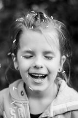Luca, March 2014 (esztervaly) Tags: portrait portraitphotography portraiture girl girlportrait blackandwhite blackandwhiteportrait blackandwhitephotography happy face bokeh bokehlicious bokehbackground flower petal