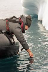 Photographing an iceberg underwater (tmeallen) Tags: iceberg underwaterphotography freezingwater barehand photographer lifevest zodiac travel adventure denmarkisland scoresbysund eastgreenland gopro