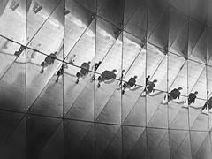 reflectiones (heinzkren) Tags: schwarzweis blackandwhite bw sw monochrome panasonic lumix london street facade again spiegelung panels paneling gb uk tube station waterlooeast architektur architecture lines abstract