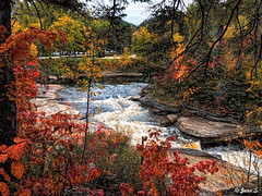 Colors (Jean S..) Tags: river water trees waves waterfall colors autumn fall sky clouds nature stone