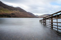 Lead the way... (judi may) Tags: lakedistrict buttermere lake water fence mountains longexposure clouds cloudysky canon5d